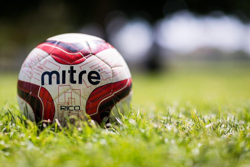 football ball on grass pitch