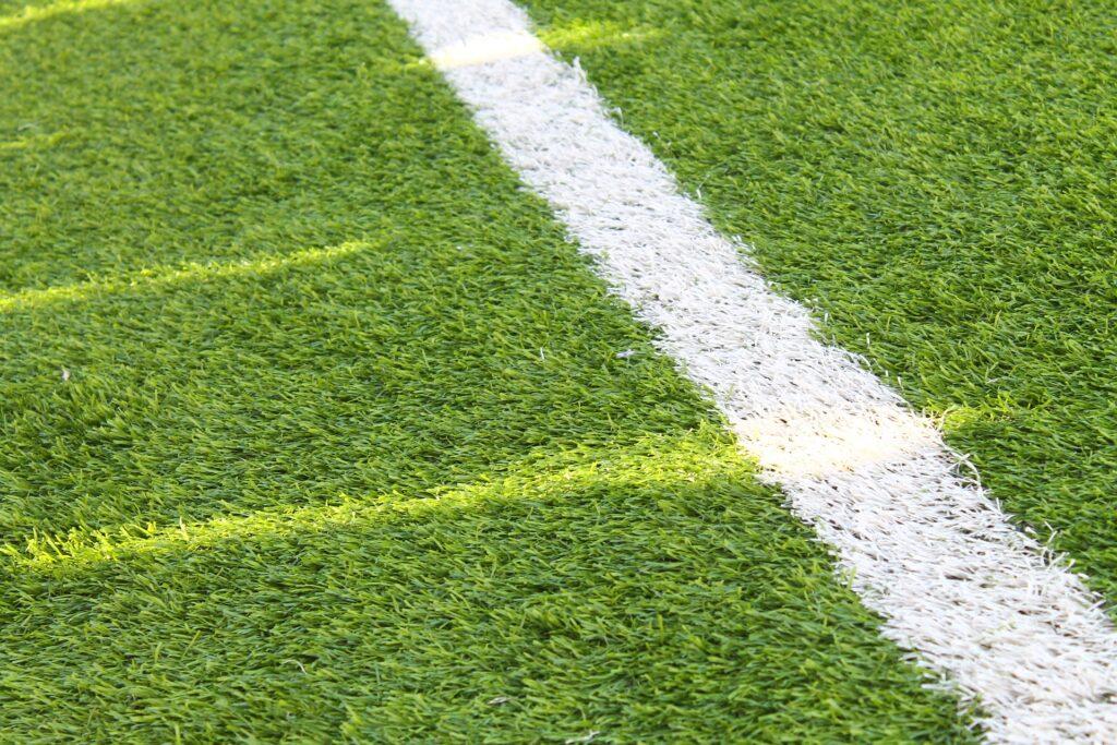 Artificial grass playing field
